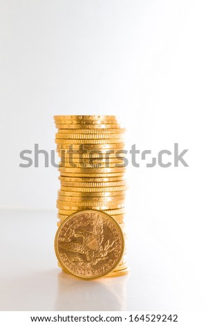 Gold coins over light background - stock photo