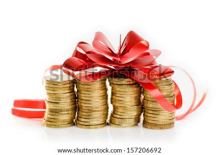 gold coins with a red gift bow. Concept of pecuniary profit. - stock photo