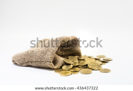 Gold coins with sack bag on with white background.For business and financial concept.