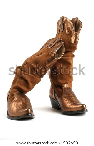 gold colored cowgirl boots - stock photo