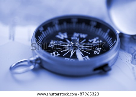 Gold compass & map - stock photo