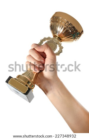 Gold cup in hand isolated on white - stock photo
