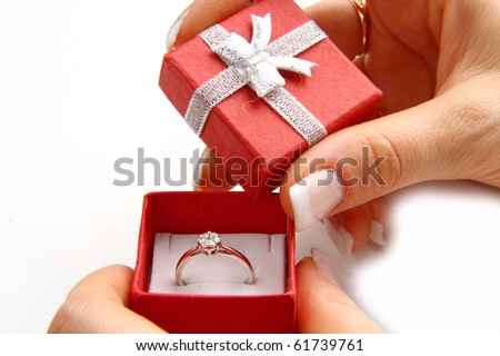 gold diamond ring in a red box - stock photo