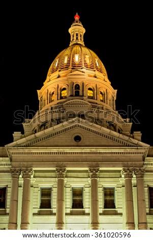 Gold Dome - Exterior - A December close up night view of Gold Dome of Colorado State Capitol Building, Denver, Colorado, USA. - stock photo