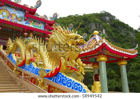 Gold dragon statue in a Chinese temple. - stock photo