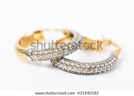 Gold Earrings With Diamonds On White - stock photo