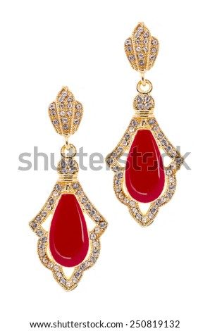 Gold earrings with red stone on a white background - stock photo