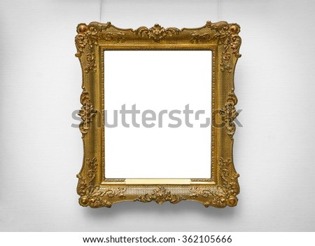 Gold empty frame on white wall - stock photo