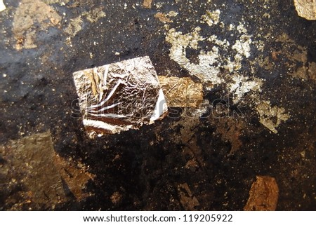 Gold foil on the old gold. - stock photo