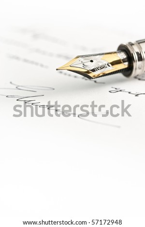 Gold fountain pen with hand written text and signature - stock photo