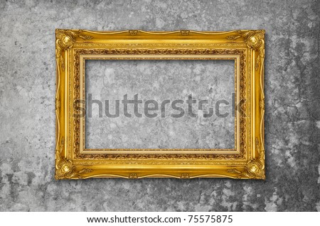 Gold Frame on a cement surface - stock photo