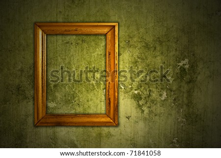 Gold frame on a old wall background - stock photo