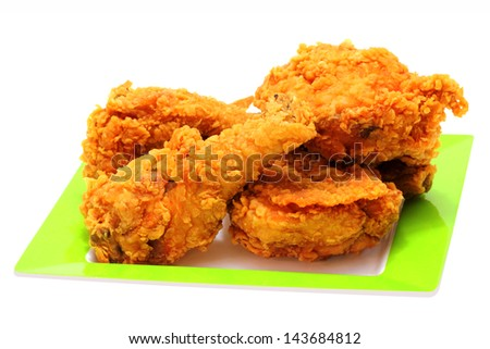 Gold fried chicken on Green plate isolate on white background - stock photo