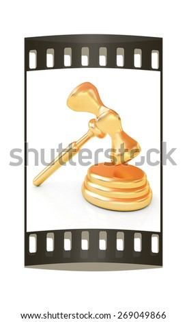 Gold gavel isolated on white background. The film strip - stock photo