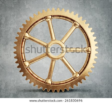 gold gear isolated on a grey background