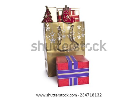 gold gift bags and boxes for Christmas and the new year on a white background - stock photo