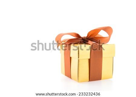 Gold gift box isolated on white background - stock photo