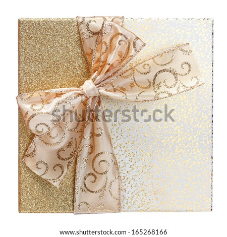 Gold Gift Box isolated on white background. Beautiful Christmas Present with Golden Glitter Bow. Front of Candy Box - stock photo