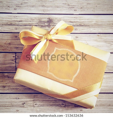 Gold Gift Box With Retro Filter - stock photo