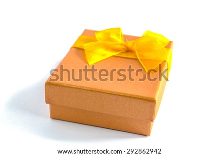 gold gift box with yellow ribbon isolated on white background
