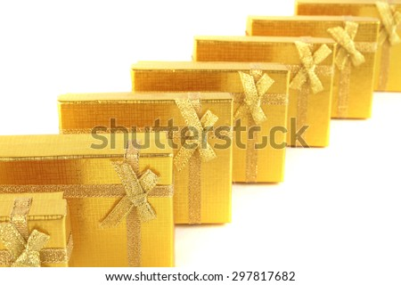Gold gifts on line on white background - stock photo