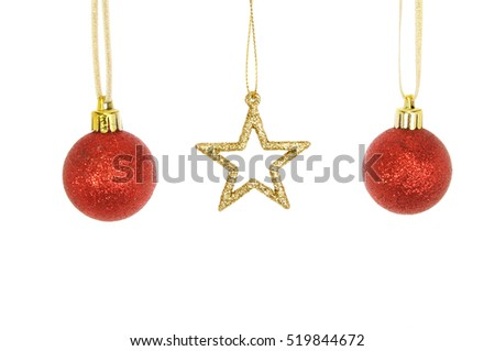 Gold glitter Christmas star and red glitter baubles isolated against white