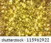 Gold glittering background. - stock photo