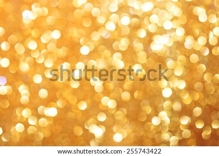 Gold glittering christmas lights. Blurred abstract background - stock photo