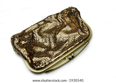 Gold Glomesh clutch purse, circa 1975, isolated on white - stock photo