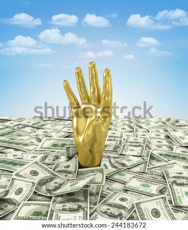 Gold hand makes its way through a bunch of dollars. - stock photo