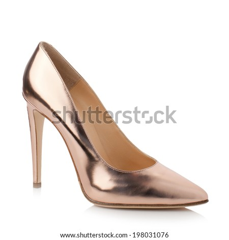 Gold high heel women shoe isolated on white background.