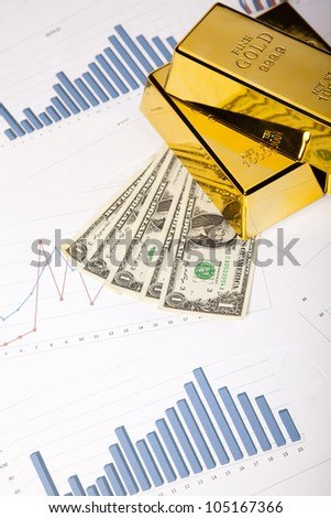 Gold Ingot on a Chart - stock photo