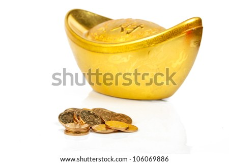 Gold ingot with coin - stock photo