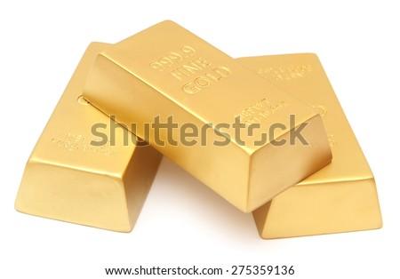 Gold ingots on white - stock photo