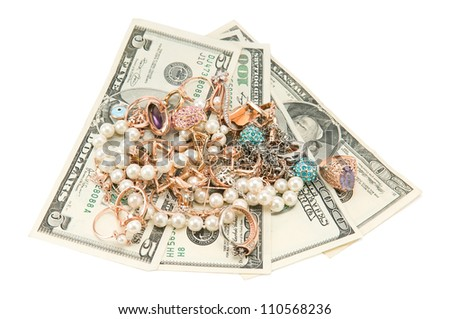 gold jewelry and dollars - stock photo