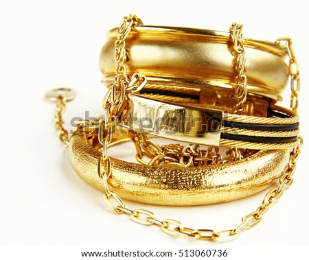 Gold jewelry, bracelets and chains. Luxury accessories.