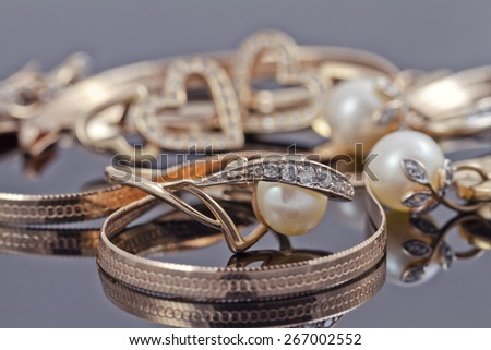 gold jewelry mixed : rings, chains and earrings - stock photo