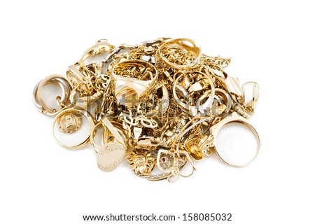 Gold jewelry on a white background - stock photo