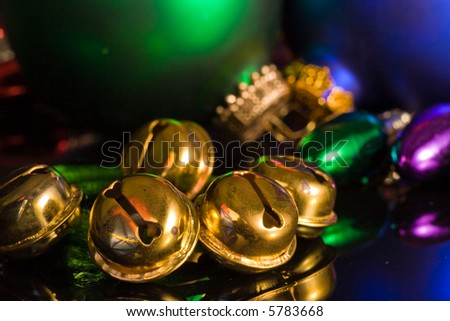 Gold jingle bells with green and blue ornaments