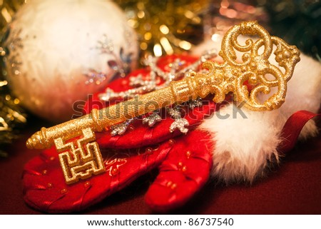 Gold key against Christmas toys - stock photo