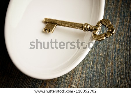 Gold Key in White Dish