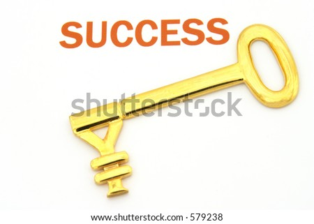 "Gold key with yen symbol next to the word ""success"""