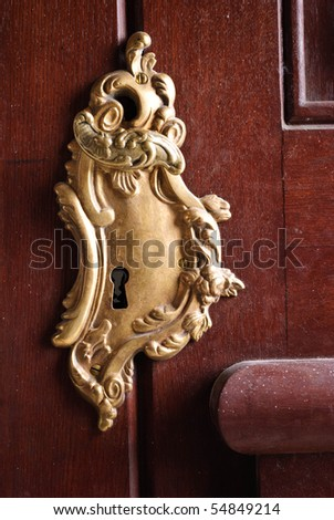 Gold keyhole on wooden door detail