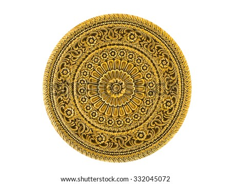 Gold lacquered metal art piece engraved in Thai floral design isolated on white background - stock photo