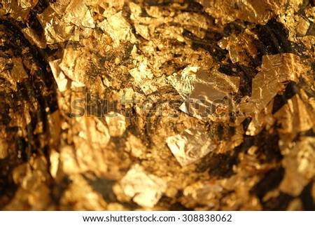 Gold Leaf ,Gold paper texture on Buddha sculpture