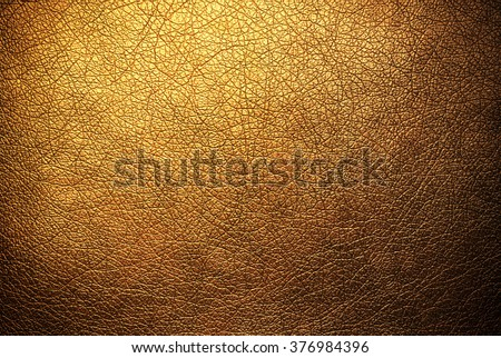 Gold leather texture background surface - stock photo