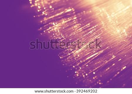 gold light fiber optic, high speed technology of digital telecommunication. - stock photo