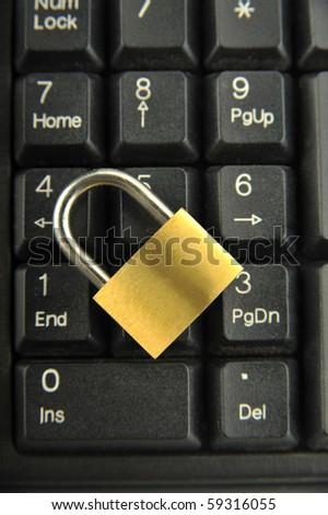 Gold Lock on black Keyboard - stock photo