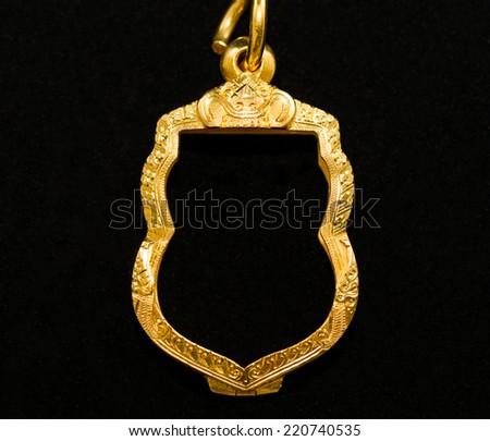 Gold locket frame pendant on black stock photo 220740535 gold locket frame pendant on black background aloadofball Gallery