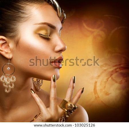 Gold Makeup.Fashion Girl Portrait - stock photo
